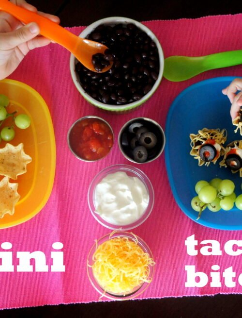 Mini Taco Bites and fixings showcased on a table with little hands making them
