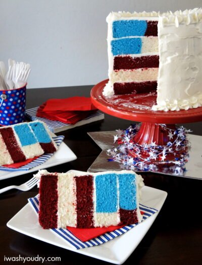A cake sitting on top of a table with slices missing and two slices of cake on plates in front of it