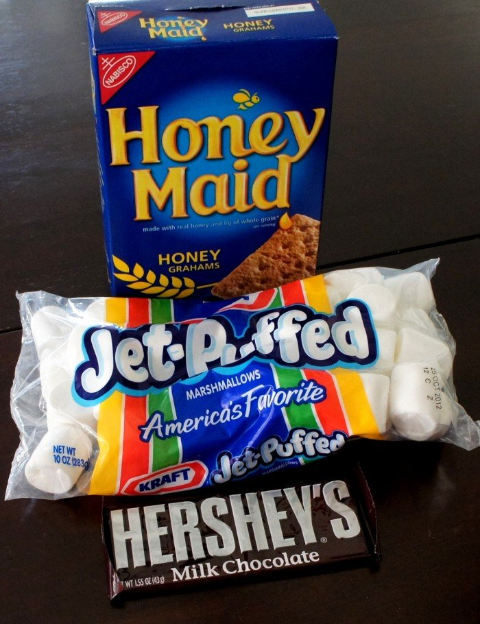 A box of graham crackers, a bag of marshmallows and a bar of chocolate