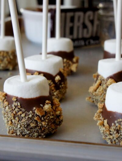A close up of a pan of S'more dipped marshmallow pops