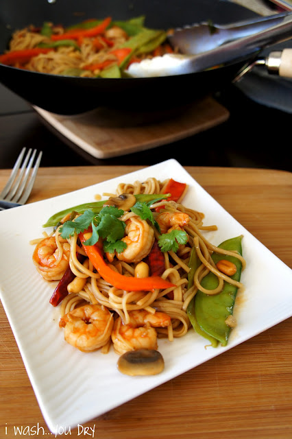 Kung Pao Shrimp Lo Mein displayed on a square plate