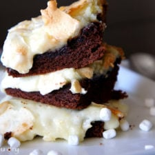 A close up of a couple Gooey Hot Chocolate Cake Bars stacked on a plate
