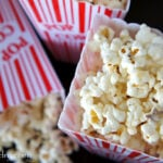 A close up of Cinnamon and White Chocolate Popcorn displayed in a popcorn container