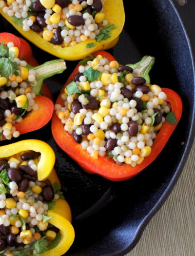A close up of a pan filled with Couscous Stuffed Peppers