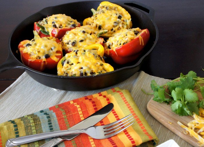 Stuffed peppers in a skillet displayed on a table