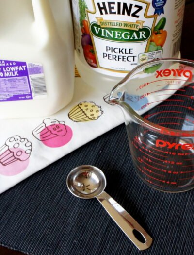 A display of ingredients needed to make buttermilk substitute using milk and vinegar