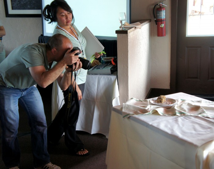 Diane and Todd styling food and taking pictures at EVO Conference