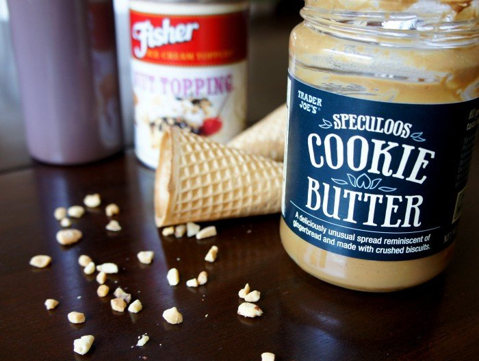 Showcasing a jar of cookie butter next to an empty ice cream cone