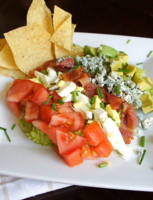 A plate showcasing Cobbocado Guacamole with a side of chips