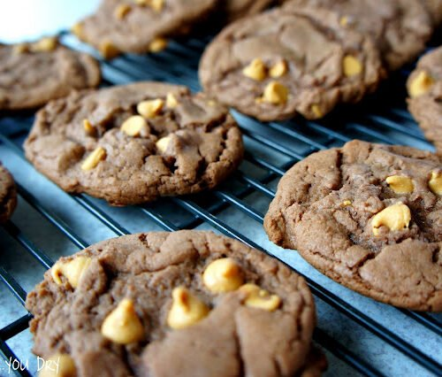 Chocolate cookies with peanut butter chips on a cooling rack