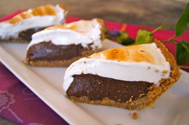 Three slices of Peanut Butter S'mores Meringue Pie displayed on a plate