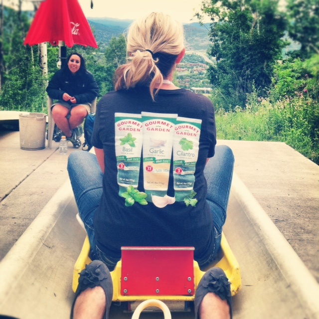 The back of Shawn from I Wash You Dry going down the Alpine Slide