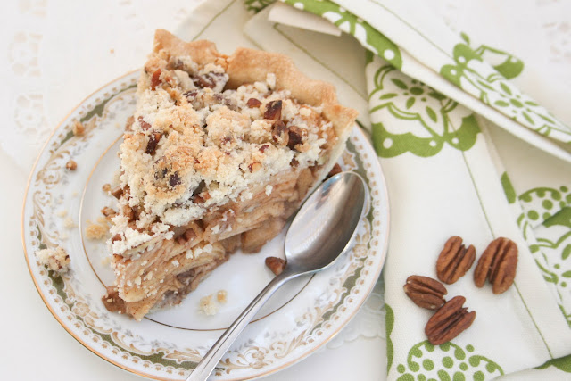 A slice of apple pecan pie on a plate