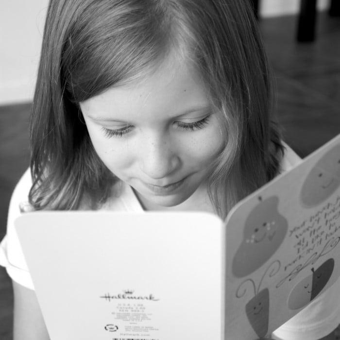 A girl looking at a greeting card