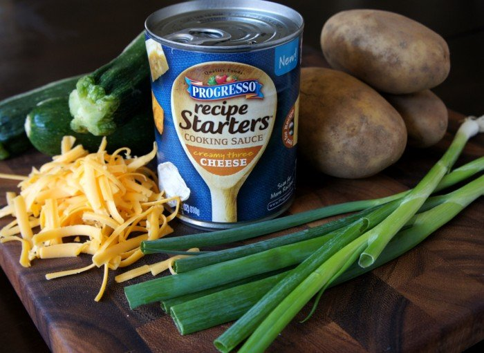 A display of ingredients needed to make Cheesy Zucchini and Potato Casserole