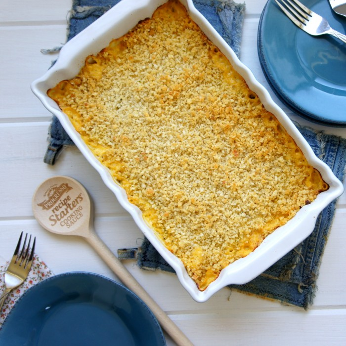 A pan of Cheesy Zucchini and Potato Casserole displayed on a table