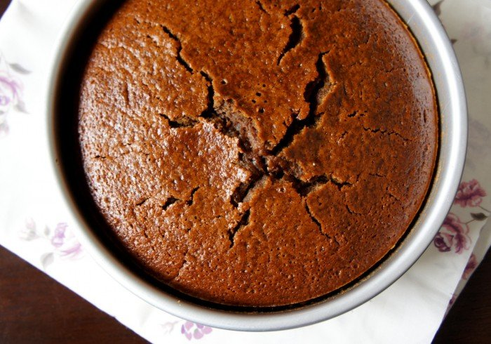 A look down on a baked cake in a pan