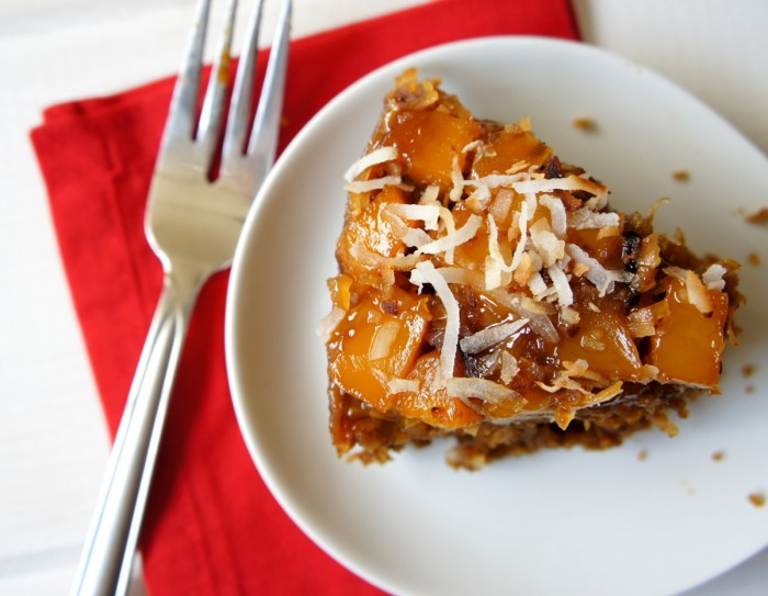 A slice of Mango Upside Down Gingerbread Cake  on a white plate