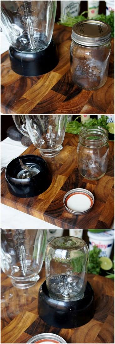 A blender blades, an empty mason jar, a mason jar lid and blender on a cutting board