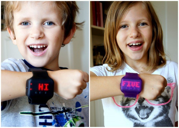 A boy and girl demonstrating the words on a Text Band