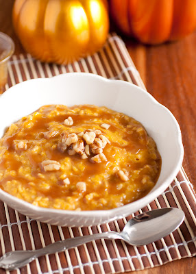 A bowl of Pumpkin Pie Oatmeal with Caramel Sauce on a table