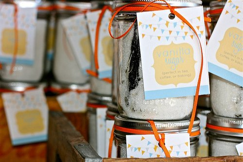 Stacked mason jars with Homemade Vanilla sugar and gift tags attached to each