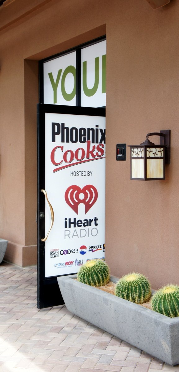 """A sign that says, \""""Phoenix Cooks - hosted by iHeart Radio\"""""""