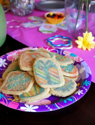 A plate of sugar cookies on a party plate