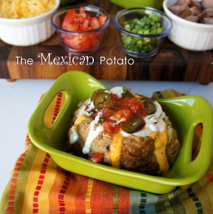 A baked potato on a green plate with a Mexican themed potato bar toppings