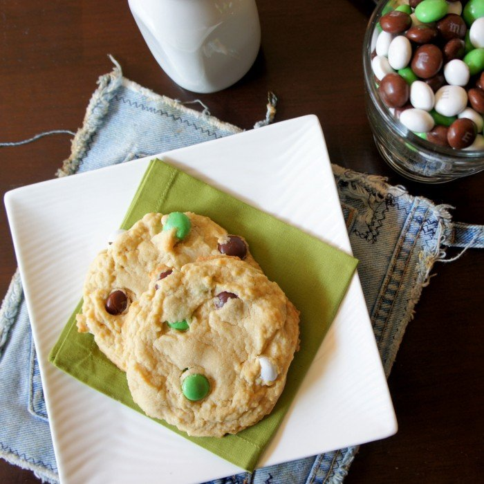 Two Coconut M&M Cookies on a green napkin on a plate