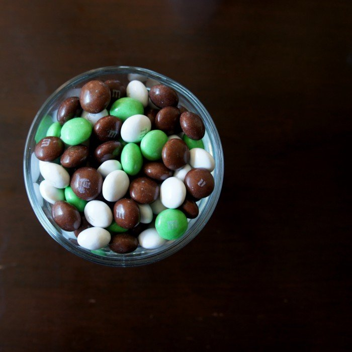 A bowl of green, white and brown Coconut M&Ms