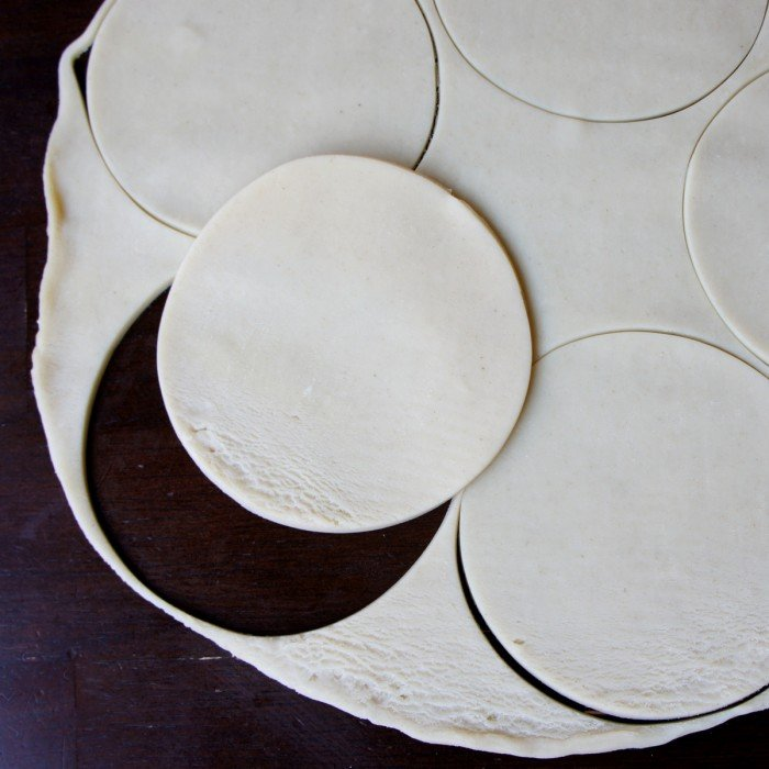 Raw pie crust cut into small round circles