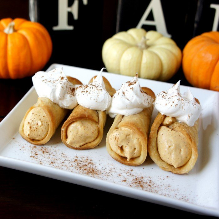 A plate of Skinny Pumpkin Pie Cannolis topped with whipped cream