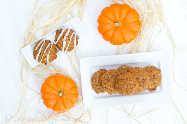 A look down of Pumpkin Oatmeal Cookies on a plate next to mini pumpkins