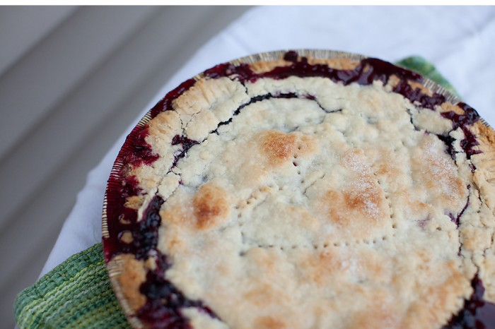 A close up of  the top of a Huckleberry Pie.