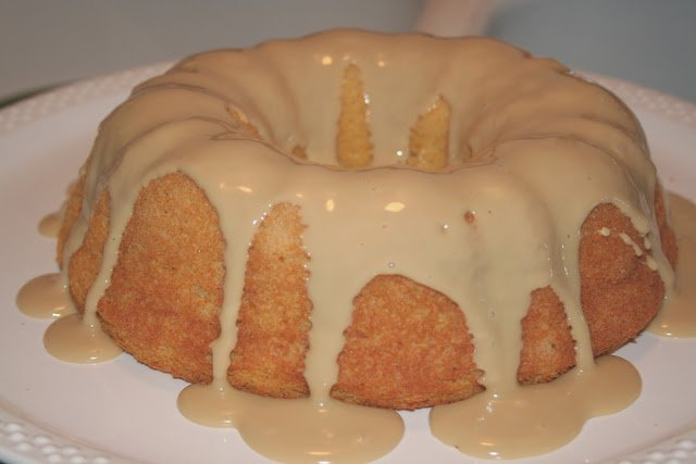 A bunt cake with frosting on it