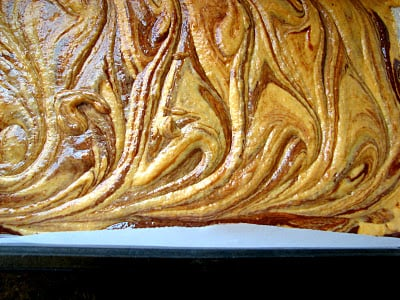 A close up of Chocolate Pumpkin Swirl Brownies in a pan
