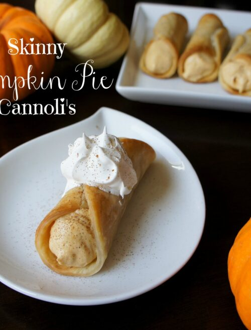 A plate displaying a Skinny Pumpkin Pie Cannoli in front of a larger platter with more cannolis