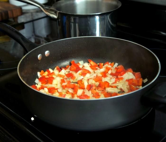 A pan cooking veggies
