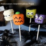 A display of Halloween themed marshmallow pops - mummy, pumpkin, Frankenstein and a vampire