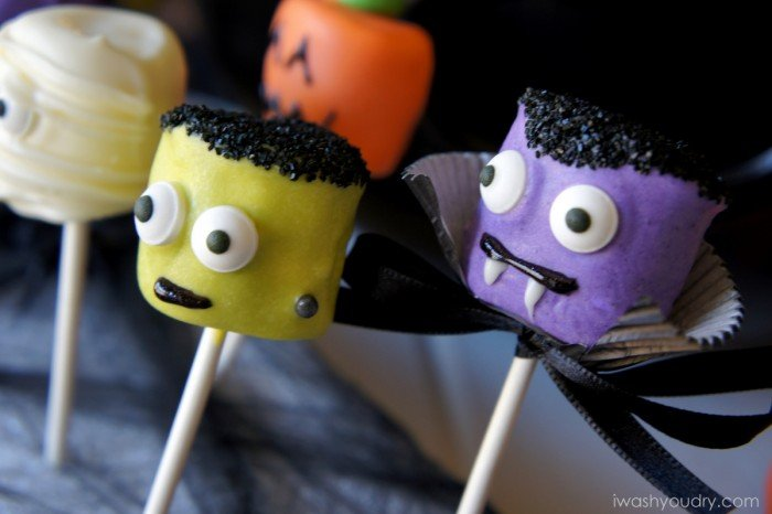 A close up view of Halloween themed Marshmallow pops -Frankenstein and a vampire