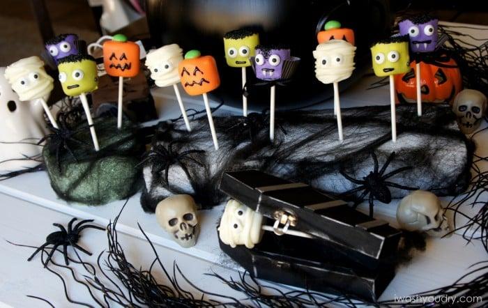 A display of Halloween themed marshmallow pops - mummy, pumpkin, Frankenstein and a vampire