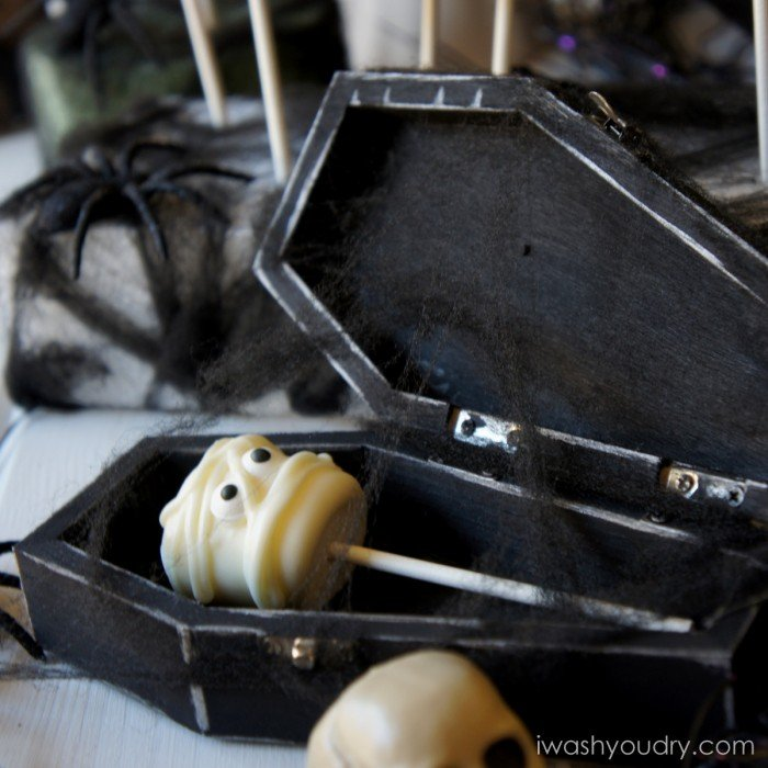 A mummy themed marshmallow pop in a coffin