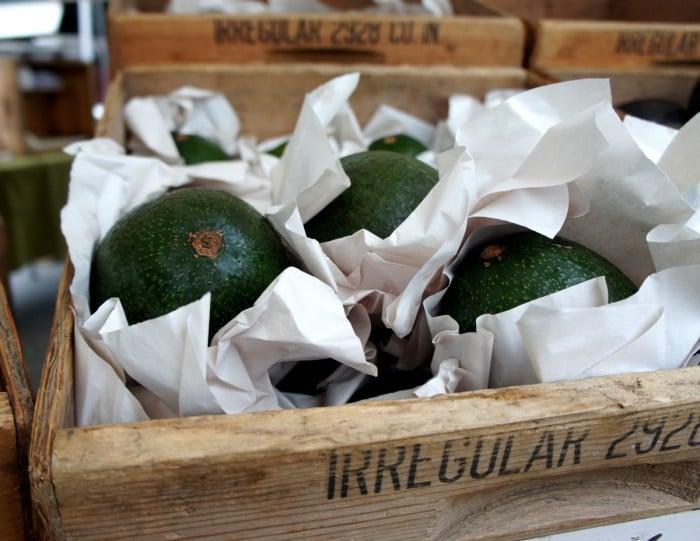 Avocados in a wooden box