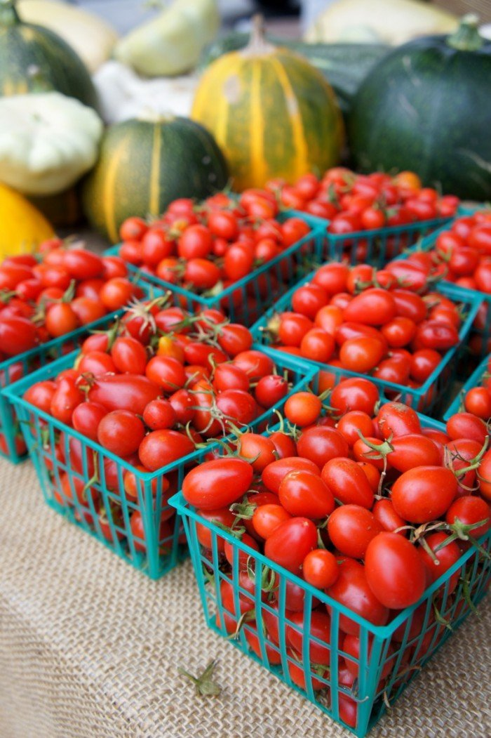 Baskets of cherry tomatoes on a table
