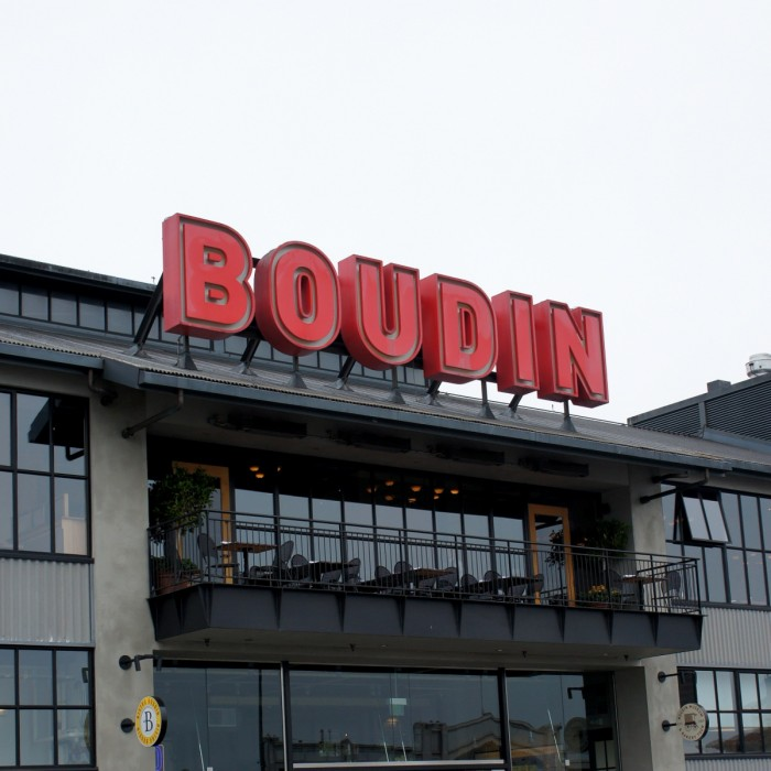 """A sign on a building in San Fransisco saying \""""Boudin\"""""""