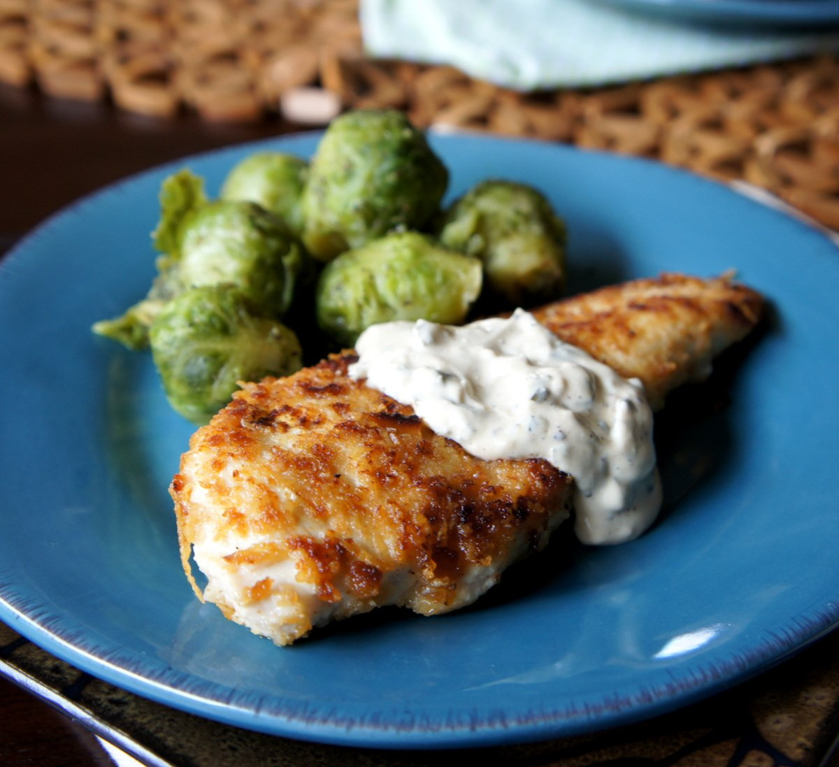 Parmesan Crusted Chicken With A Creamy Lemon Chive Sauce