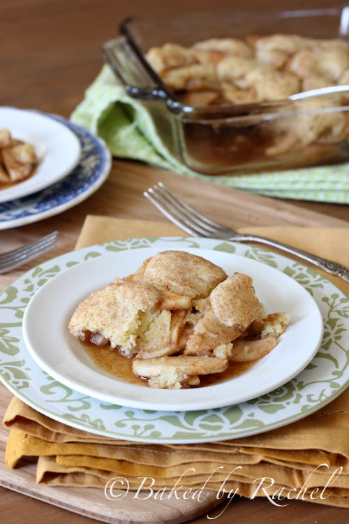 A close up of Apple Snickerdoodle Cobbler displayed on a plate on a table.