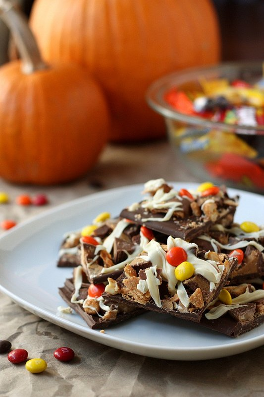 A close up of a plate with stacked pieces of Halloween Candy Bark