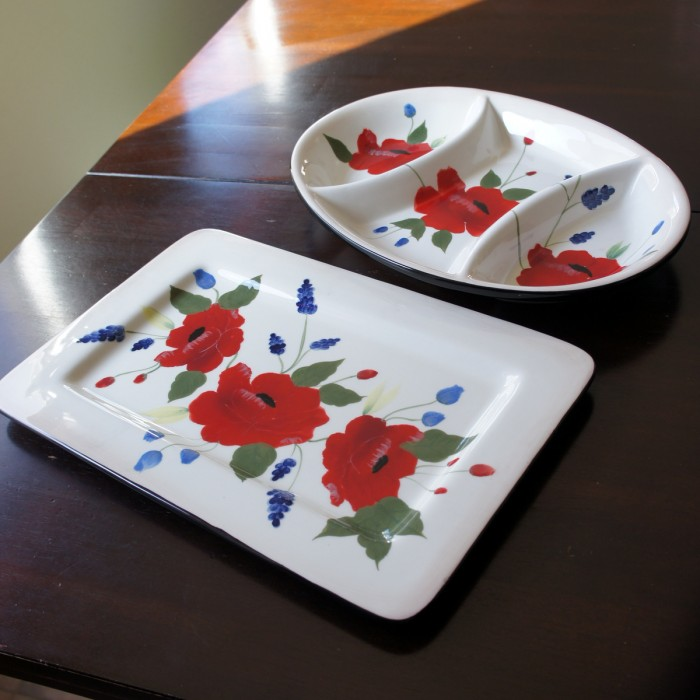 A 3 section dividing serving dish and a serving platter on a table